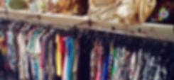 Clothing_racks_in_second_hand_shop,_Prag