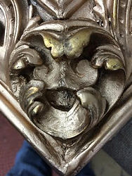 Corner piece of ornate guilded picture frame after restoration at Handmade Framing and Gallery, Bude, North Cornwall.