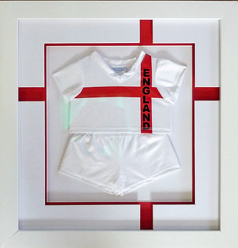 Framed England football kit with St Georges Cross bespoke mount.