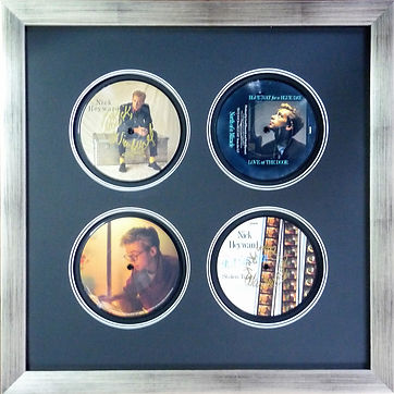 Vinyl record picture framing. Four signed picture disk records in 1 frame.
