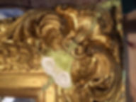 Ornate gold frame part way through restotation.