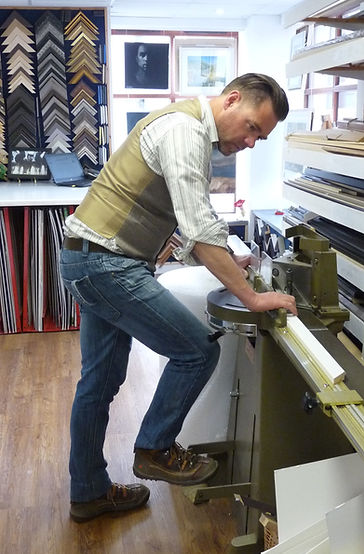 Jon Price Guild Certified Framer (APF) cutting a frame at his workshop near Bude.