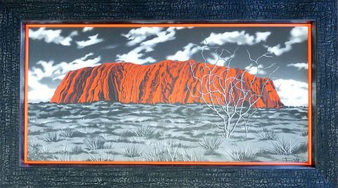 Uluru canvas print with burnt charcoal effect black frame and stacked orange inner frame by professional picture framers Handmade, Bude, Cornwall.
