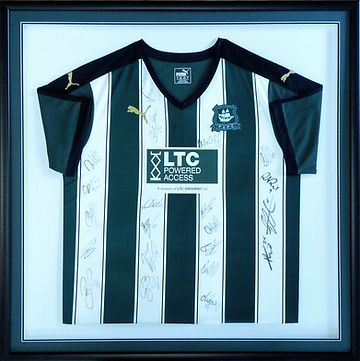 Signed Plymouth Argyle football shirt framed with matching mount colours.