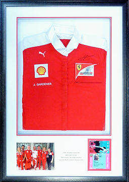 Framed Ferrari Formula 1 team shirt, pit pass and photograph.