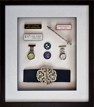 Picure framed memorabila. Nurses belt, watches and badges framed.