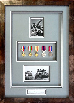 Framed medals and photgraphs.