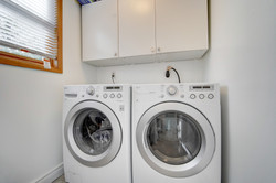 Laundry with cupboards