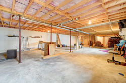 Unfinished basement with high ceiling