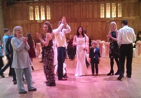 Crowd dancing to gypsy and folk songs in Dartington Hall, Devon