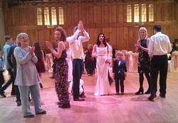 Crowd dancing to gypsy and folk songs in Dartington Hall, Devon