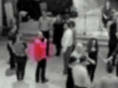 Chris Jewell calling a square dance at Dartington