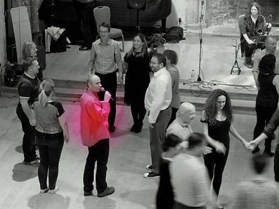 Chris Jewell calling a square dance at Dartington