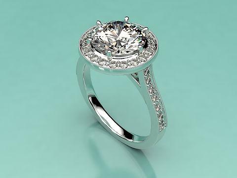 Brilliant cut Halo ring with Antique style Millegrain edge