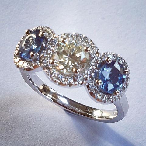 Three stone Brilliant cut Diamond and Sapphire Oval Halo ring