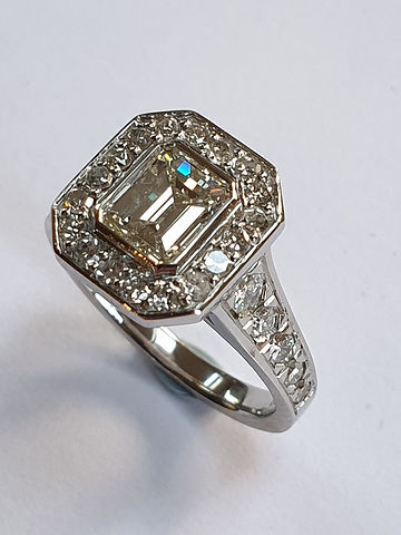 Emerald cut Deco style halo ring centre stone 1.03cts and 0.80cts pave diamonds