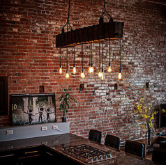 Exposed-duct-pipes-brick-walls-and-lighting-create-a-distinct-modern-industrial-style-in-the-kitchen.jpg