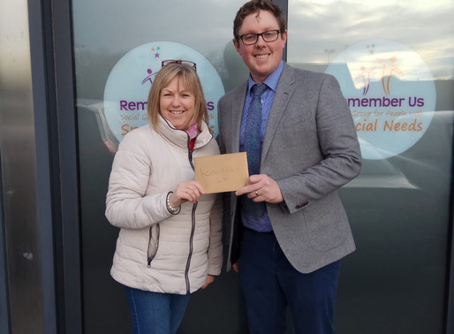 Paddy Delaney of 'InformedDecisions.ie' presents cheque for €1000 to Remember Us