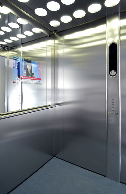 Espejo para elevador con pantalla