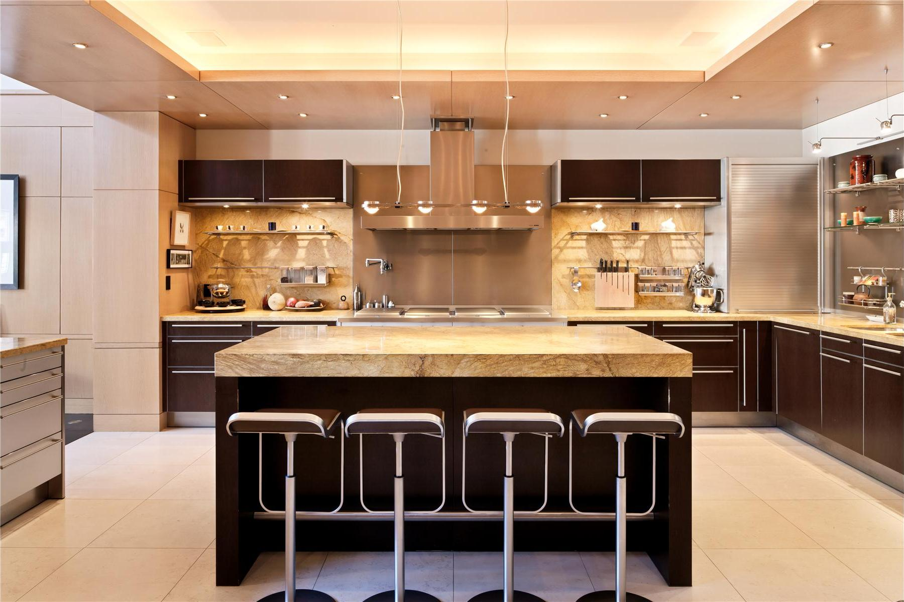 interior-dark-brown-kitchen-cabinets-with-creamy-surface-and-bar-stools-luxurious-home-interior-desi