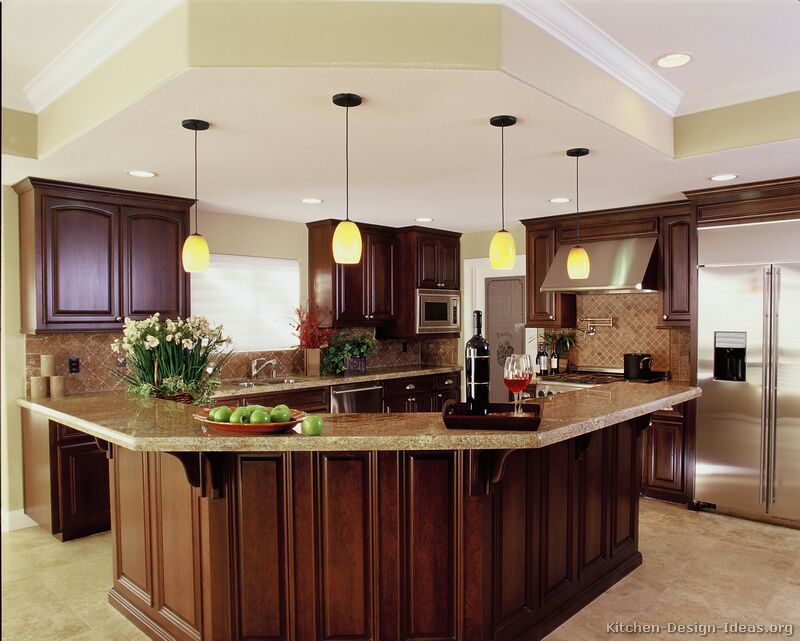 luxury-kitchen-appliances-a-luxury-kitchen-with-cherry-cabinets-and-a-large-island-dlobgaw4.jpg
