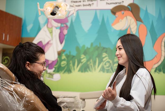 dental staff showing patient ora health tips