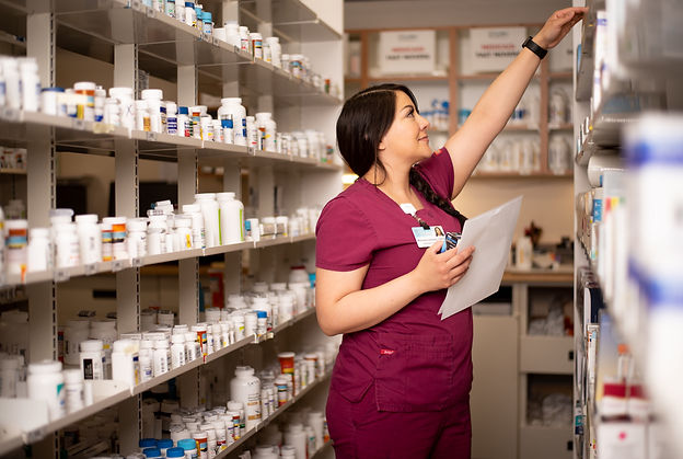 pharmacy technician grabbing prescriptions for patient