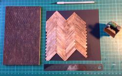 brick wall, parquet floor and desk
