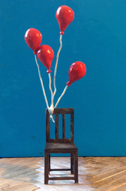 chair and balloons