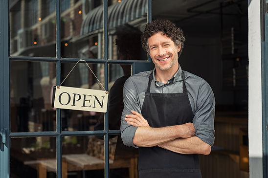 Portrait of small business owner smiling