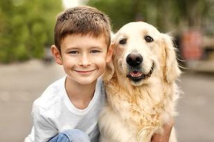 Small boy and cute dog on street.jpg