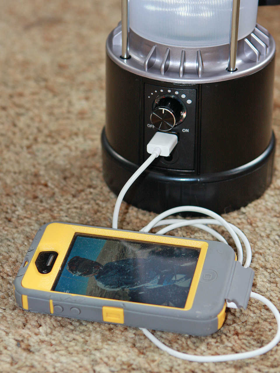 Solar Powered LED Lantern Charging Iphone