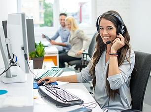 Smiling friendly female call-center agen