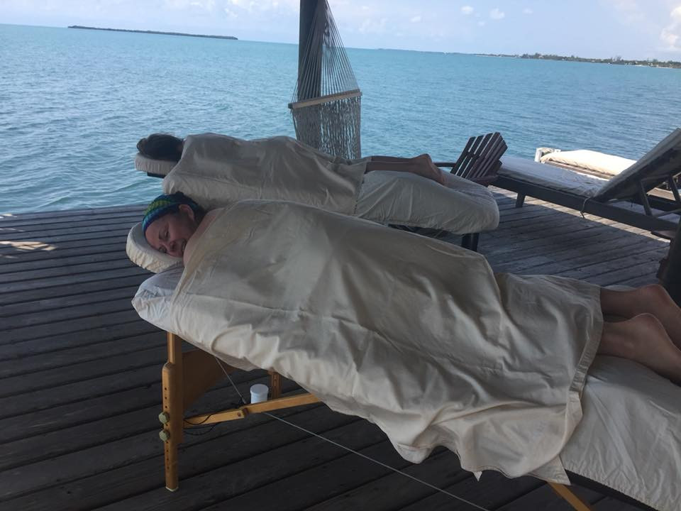 Gadabout Gals getting massages on a pier in Belize