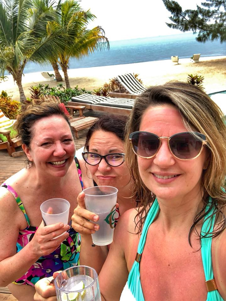 Gadabout Gals poolside in our dreamy vacation home in Belize