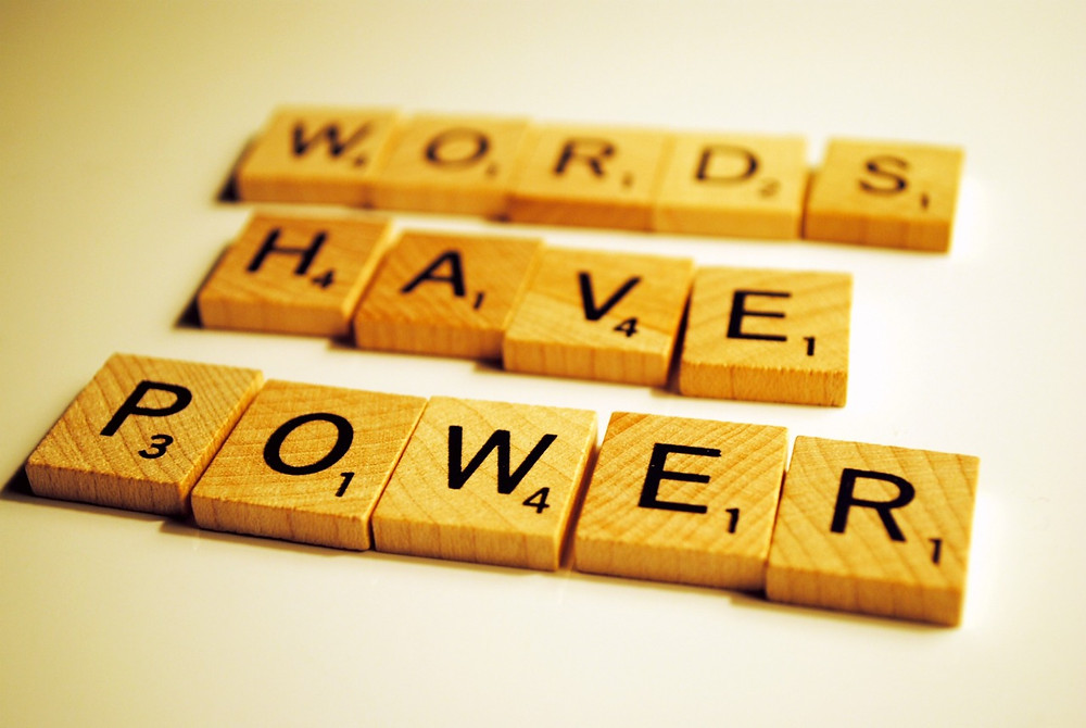 """wooden letter tiles spelling out """"Words Have Power"""""""