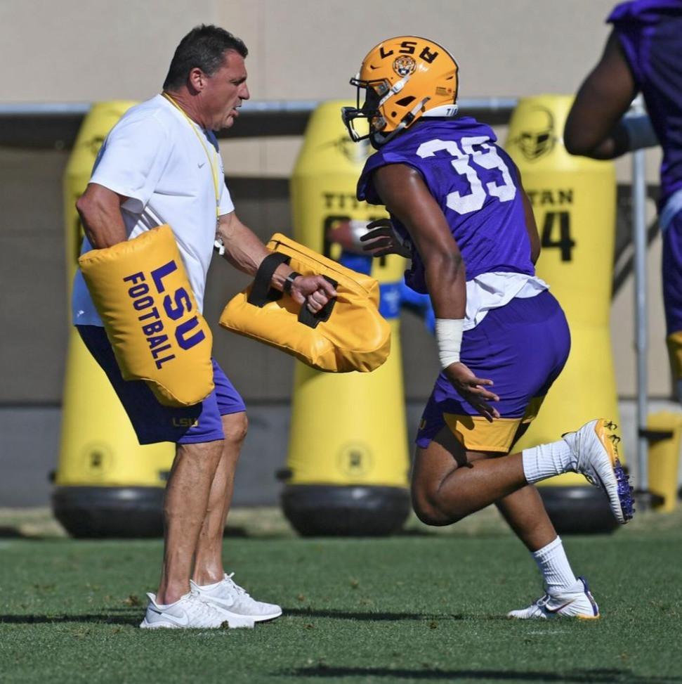 Coach O practices with LB/DE Phillip Webb