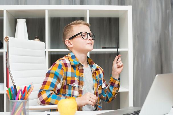 boy-with-laptop-desk_edited.jpg