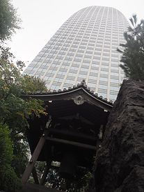 seisho-ji japanese buddhist temple tokyo with high-rise building