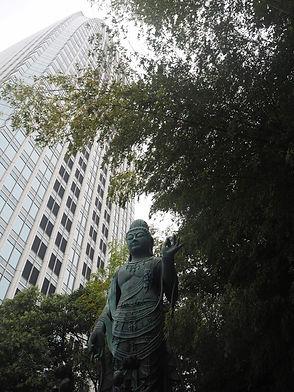 seisho-ji japanese buddhist temple tokyo garden statue highrise