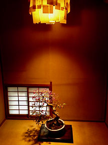 tokonoma with a hanging scroll and ikebana flower arrangement