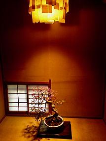 tokonoma with a hanging scroll and ikebana flower arrangement