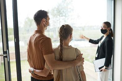 couple-listening-to-real-estate-agent-2021-09-24-04-21-17-utc.jpg