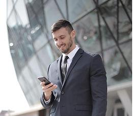 man-in-black-suit-jacket-holding-smartph