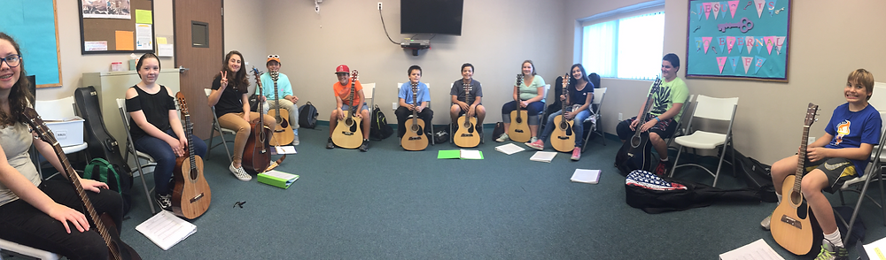 picture of my guitar class; 11 kids with guitars
