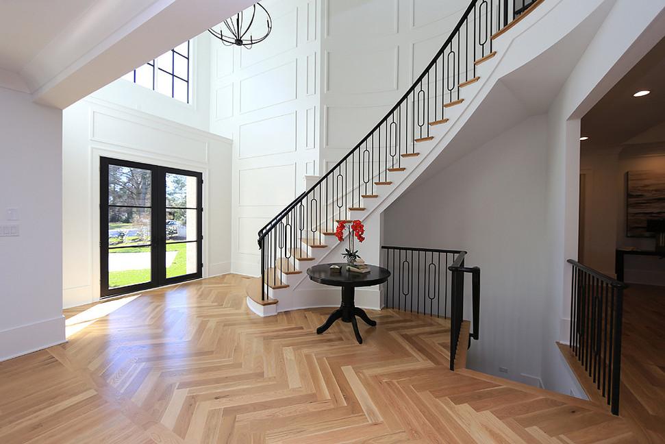 Foyer with herringbone floors