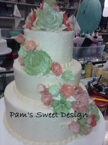 Wedding Cake: Cream with rose and sage flowers.
