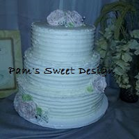 Wedding Cake: Gruved sides with butter cream roses