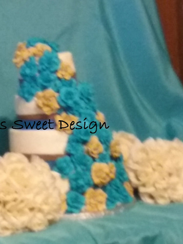 Wedding Cake: Teal and Tan royal icing flowers.