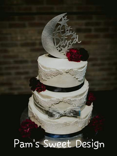 Wedding Cake: White edible fondant lace, fresh flowers